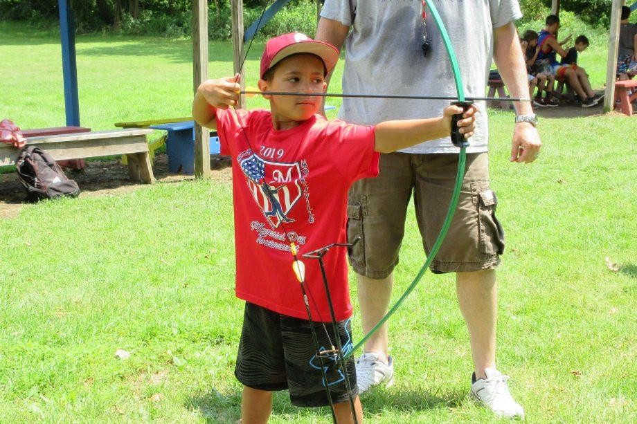 Boy shooting archery arrow