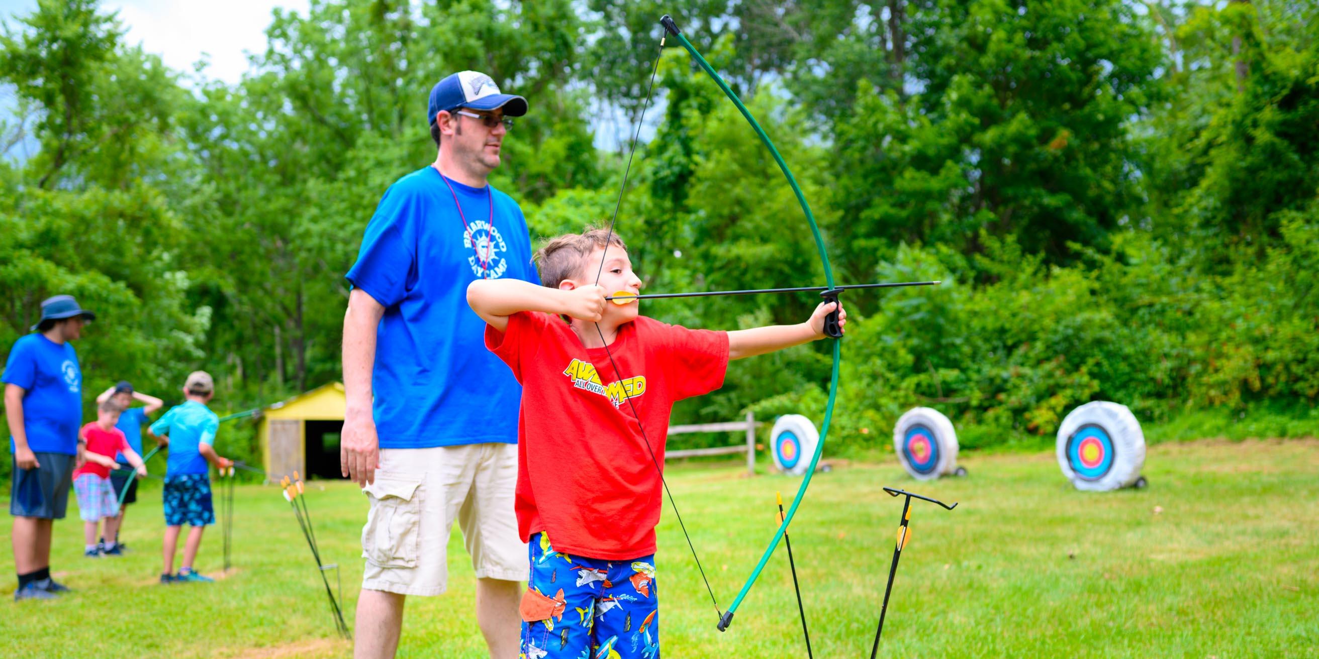 Camper shooting archery arrow