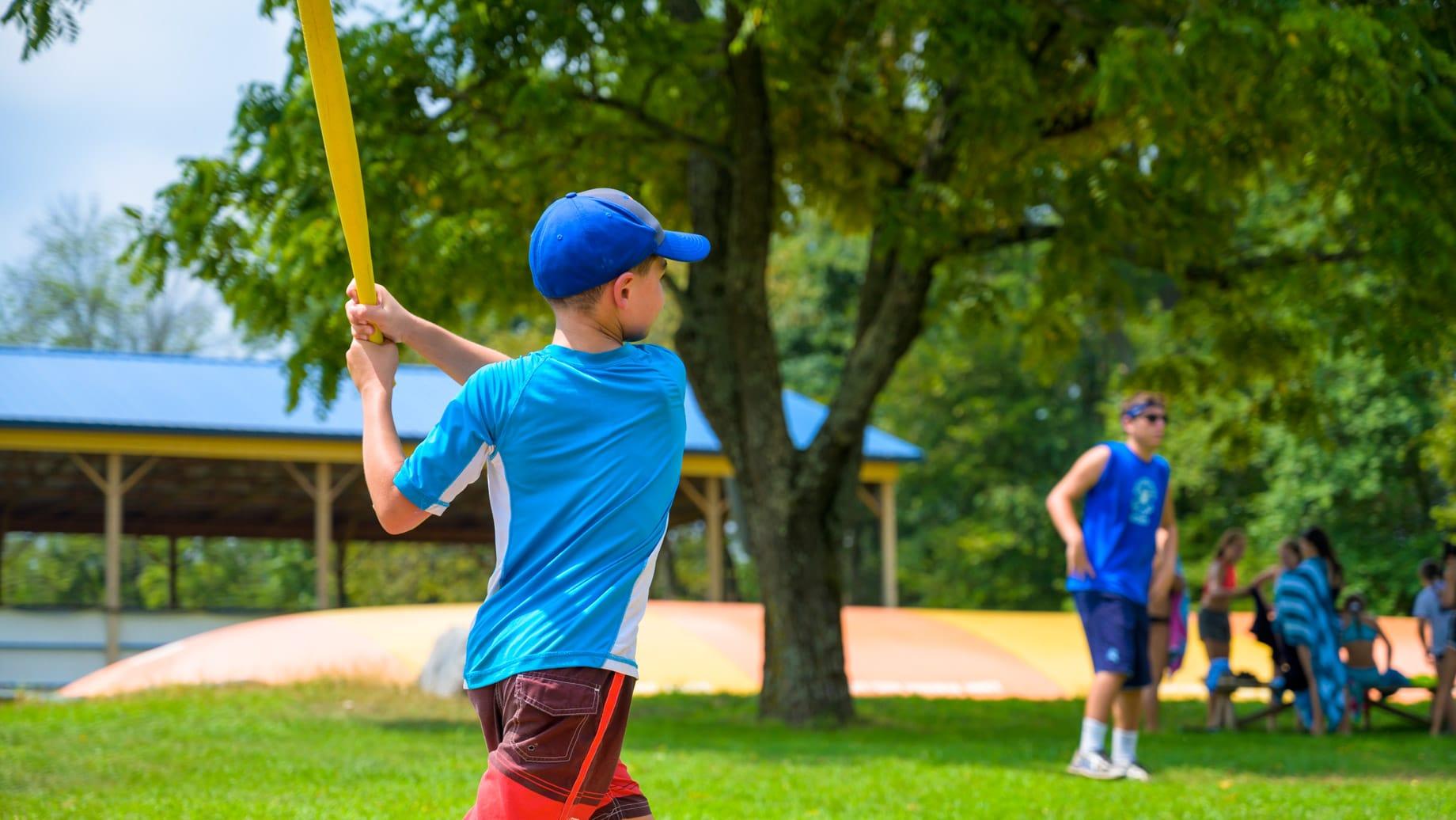 Camper hitting baseball bat