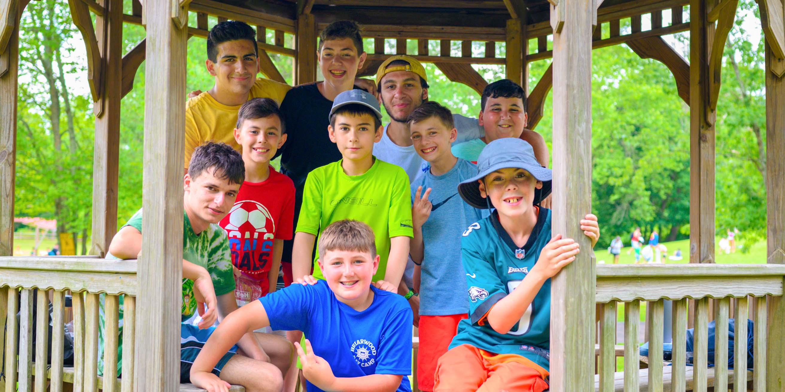 Boys in gazebo smiling