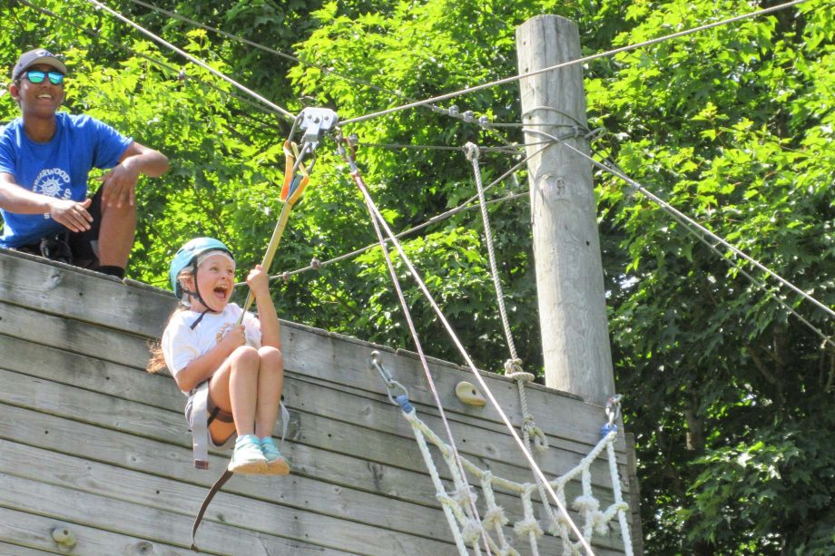 Girl going on zip line and screaming