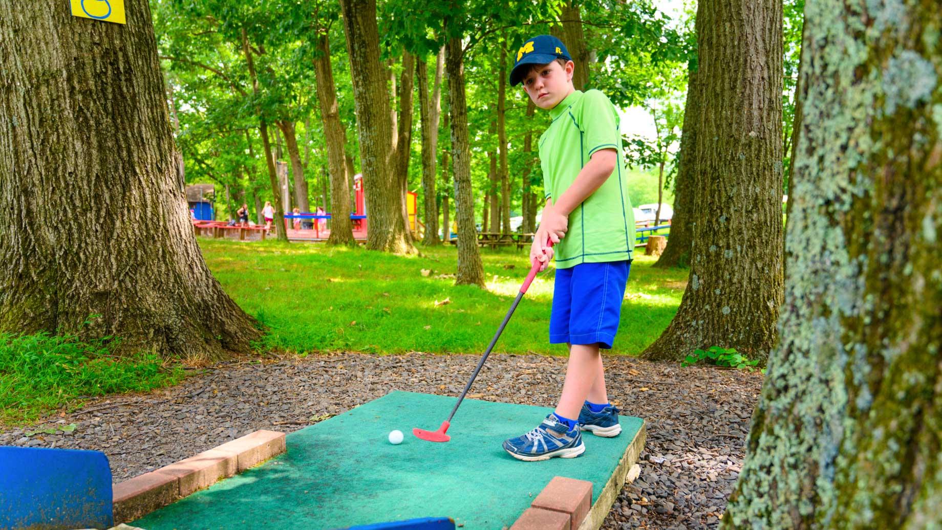 Campers golfing
