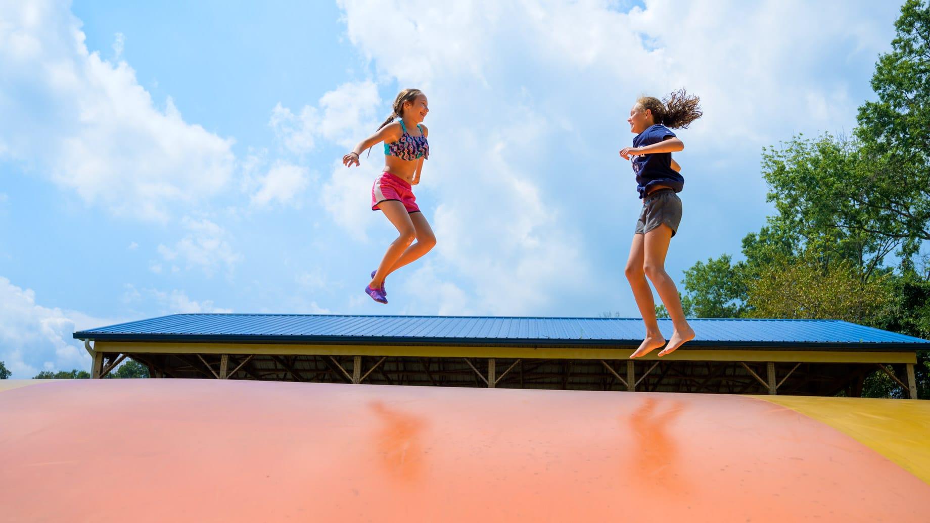 Girls on jumping pillow