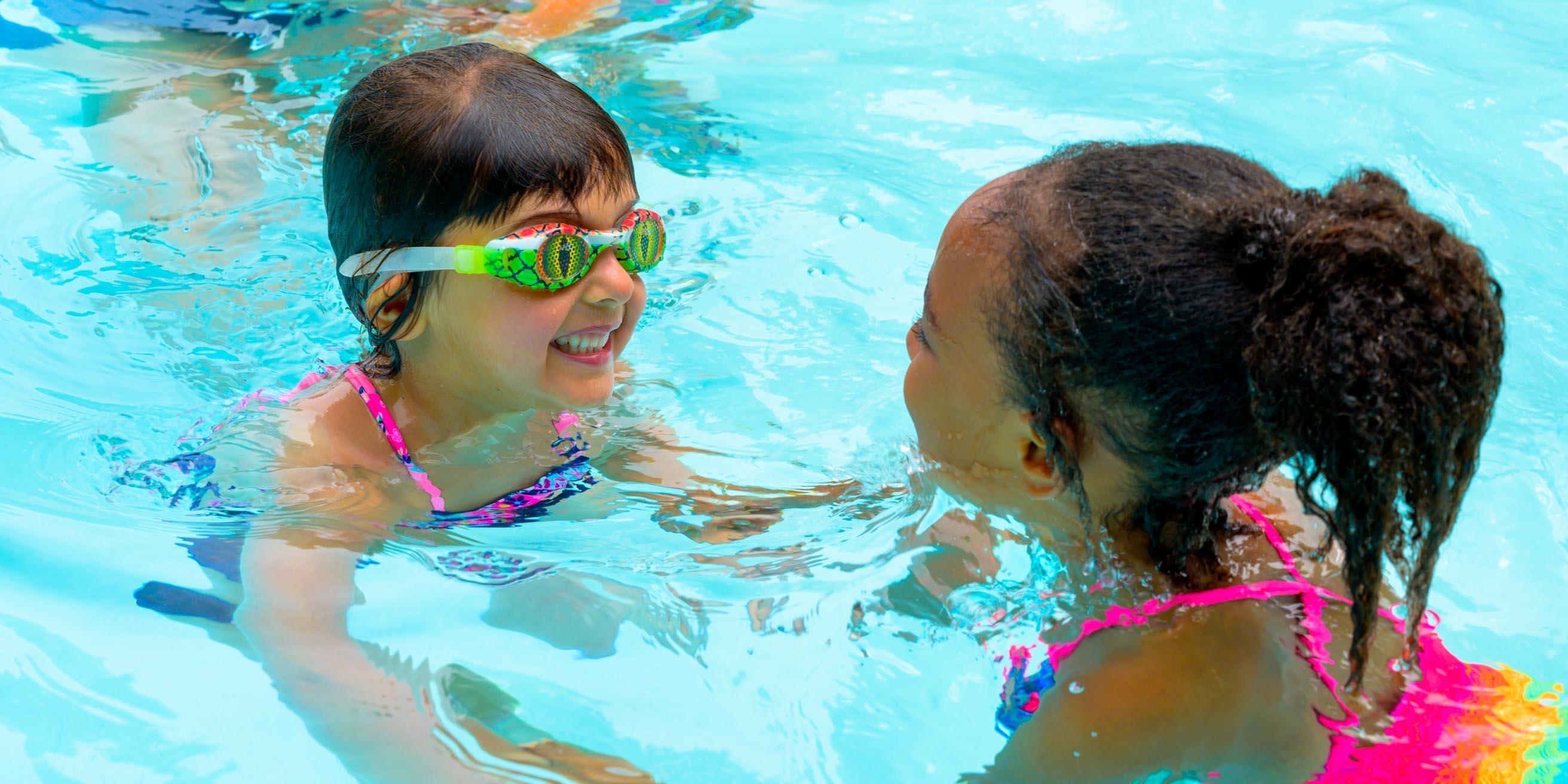 Girls laughing in pool