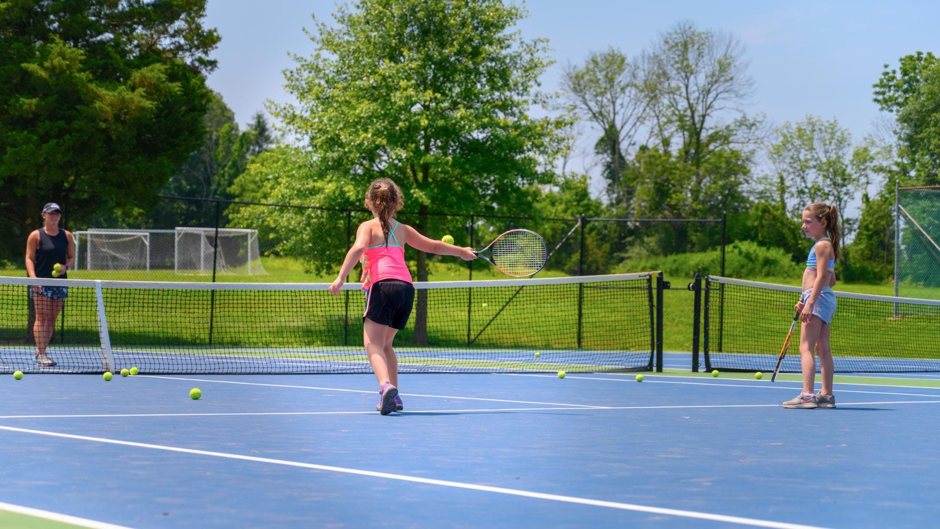 Girls playing tennis on the court
