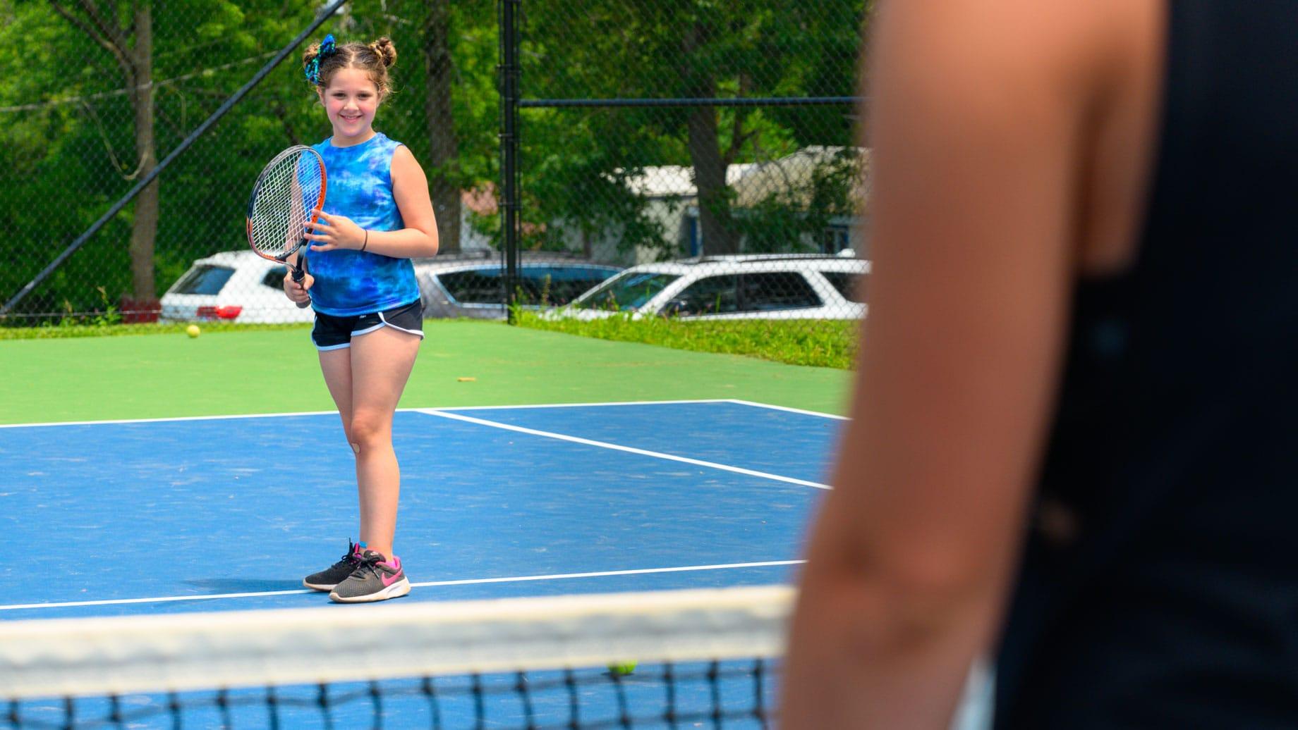 Camper playing tennis
