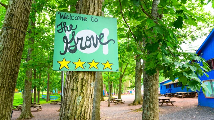 The Grove sign by picnic area