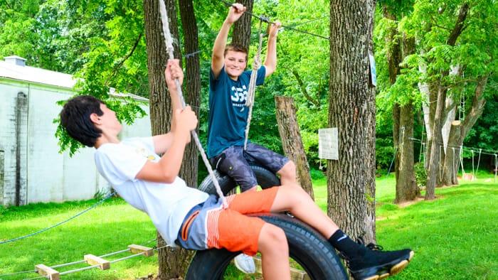 Boys on tire swings