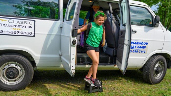 Camper getting out of camp van