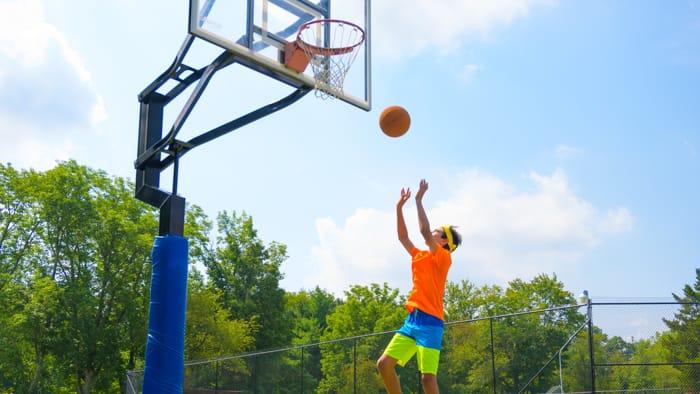 Camper playing basketball