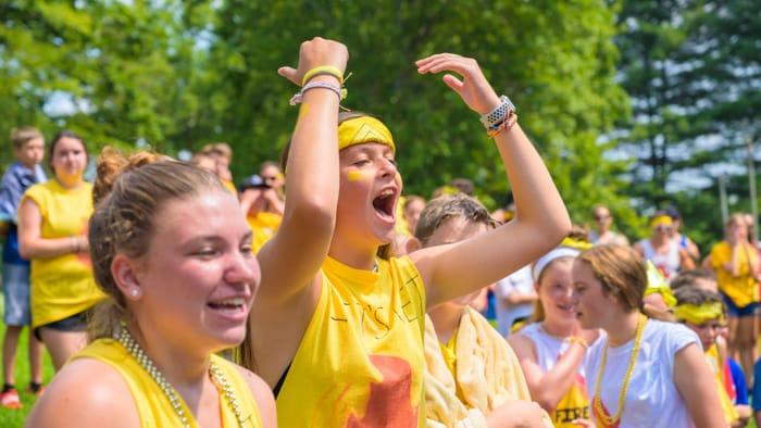 Yellow team cheering at color war