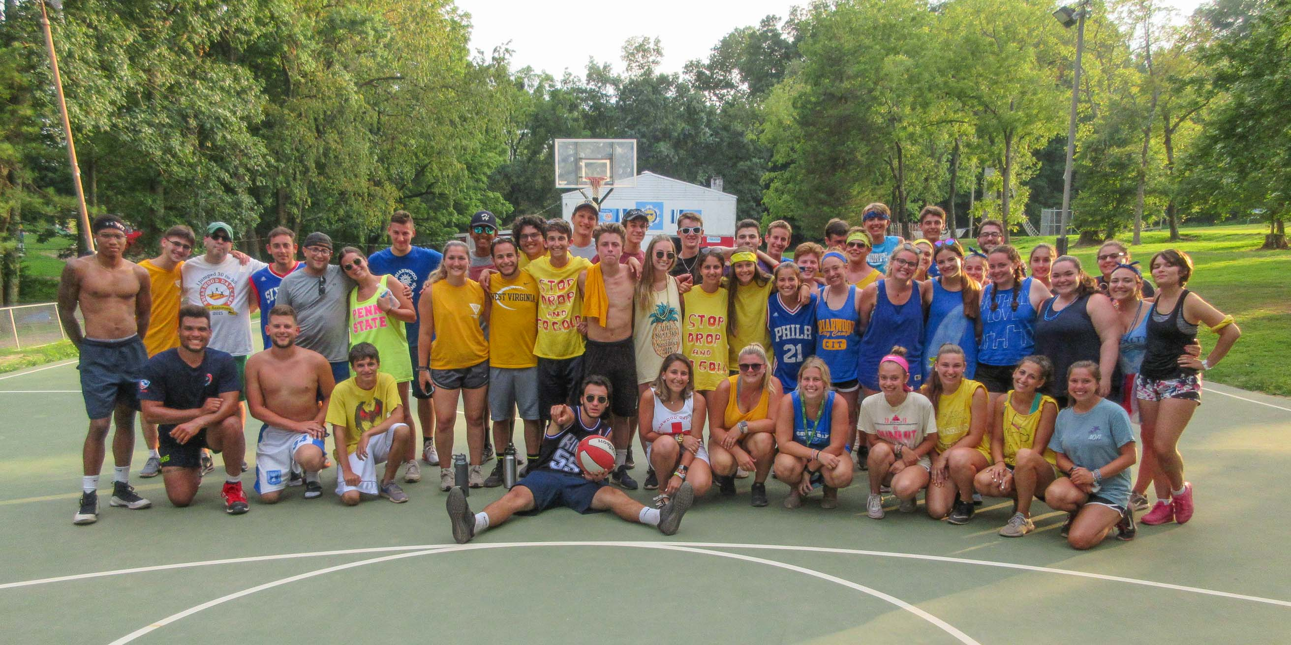 Staff group on basketball court smiling
