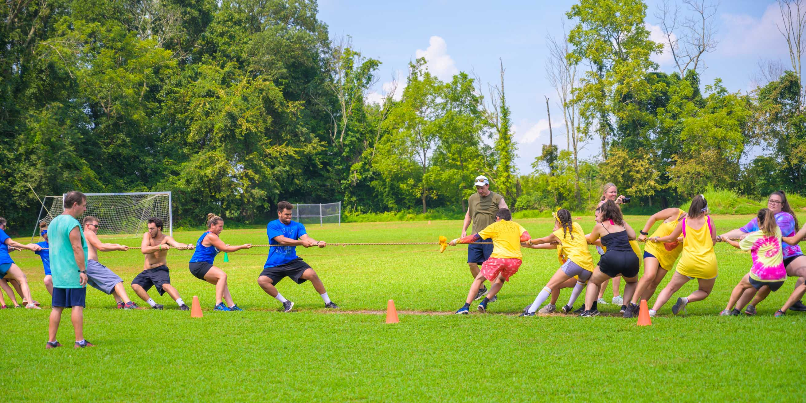 Staff playing tug-of-war during color war