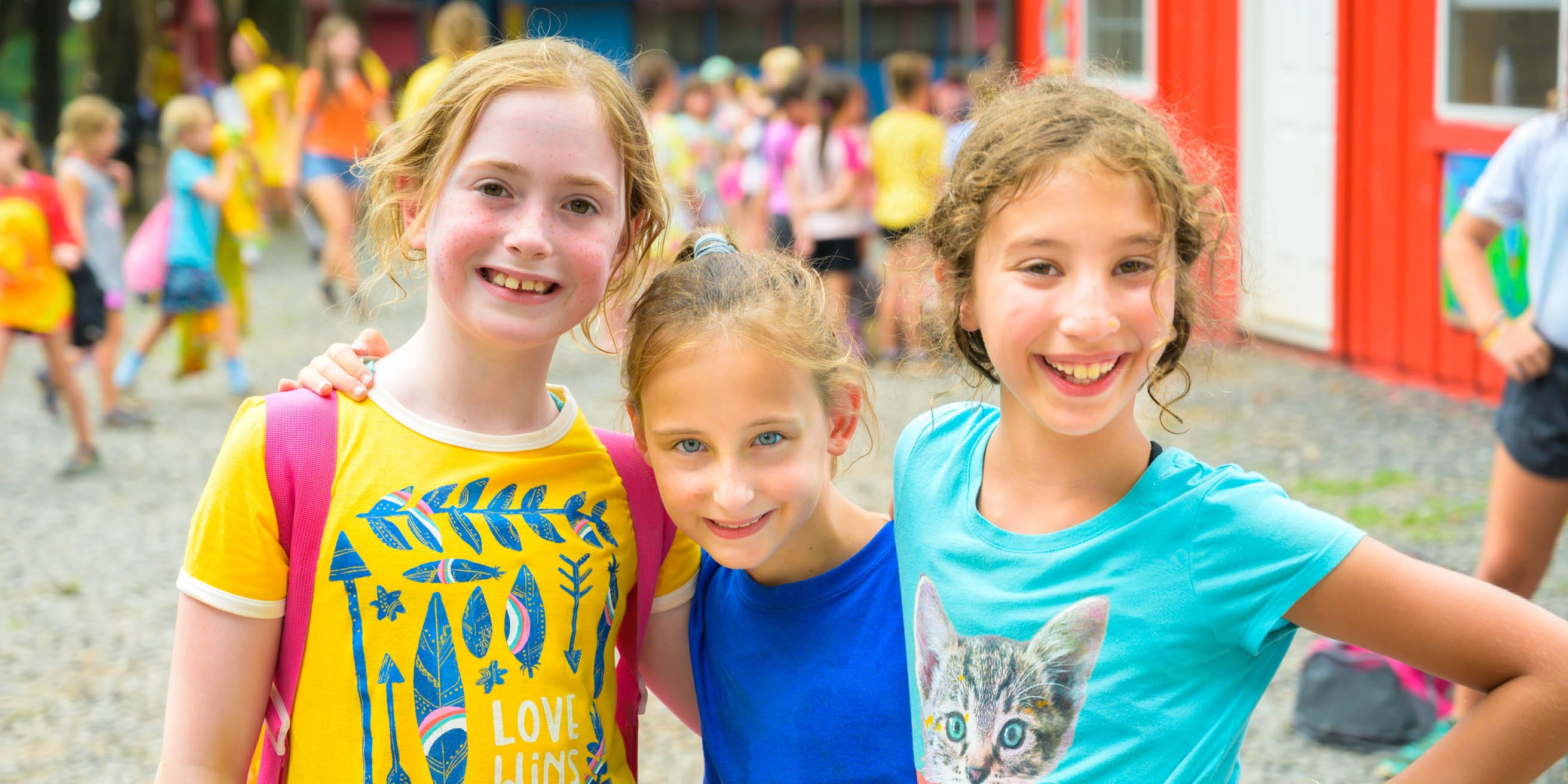 Three happy girls smiling