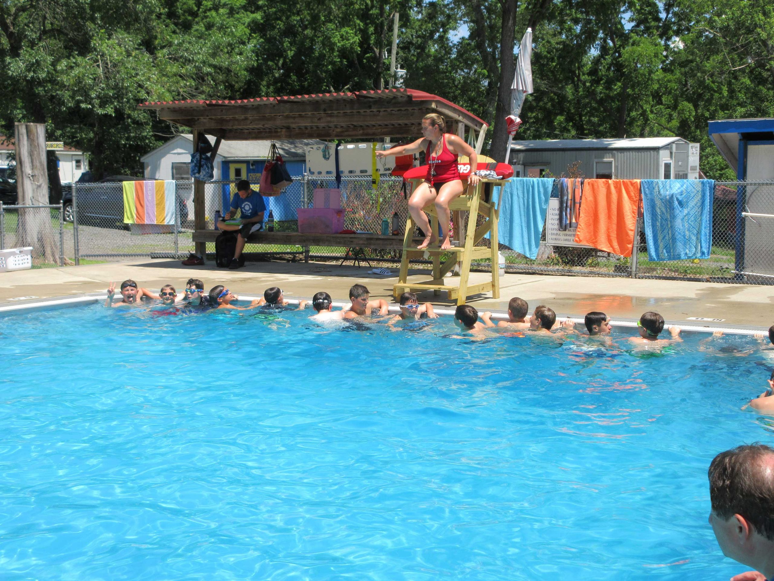 kids learning to swim at Briarwood Day Camp